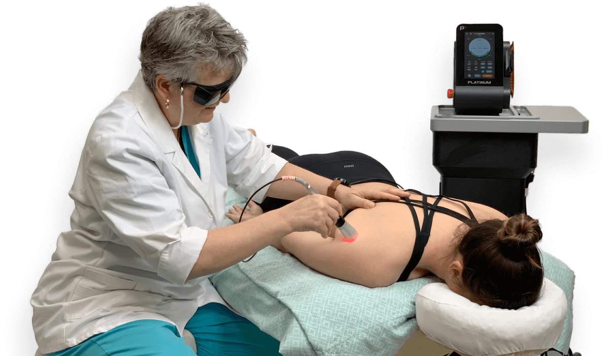 Dr. Berger performing laser therapy on a patient